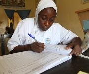 A service provider registers name of  family planning clients in a register at centre Igboro health facility in Ilorin in Nigeria's central state of Kwara, November 6, 2012.