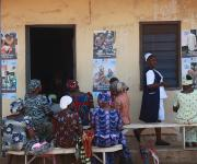 Women wait to see a doctor outside the ante natal unit at Orolodo primary health centre in Omuaran township in Nigeria's central state of Kwara, November 5, 2012.