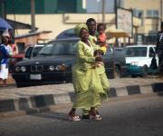 A couple, Mr and Mrs Taiwo Gabreal  cross a road with their daughter as they prepare to attend a family planning counselling session in Molete district primary health centre  in Ibadan, South-west, Nigeria, November 7, 2012.
