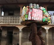 A woman hawks past an old architecture in Molete district in Ibadan, South-west, Nigeria, November 7, 2012.