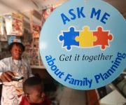 A dangler promoting family planning is seen at a barber shop in Lugbe village, outskirt of Nigeria's capital Abuja November 9, 2012.