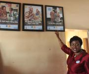The state team leader for NURHI, Stella Akinso gestures as she points to framed posters promoting family planning during a facility inspection of Oniyanrin primary health centre  in Ibadan, South-west, Nigeria November 7, 2012.