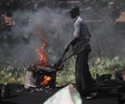 A man roasts meat in an abattoir in Kakuri district in Nigeria's northern city of Kaduna, November 12, 2012.