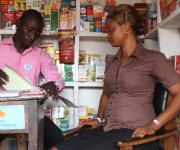 A patient medicine vendor(PMV), Hamzat Jelili attends to a client, Oluyemisi Ilesanmi, on family planning in his outlet at Kudeti district in Ibadan township, South-west, Nigeria November 7, 2012