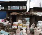 Women selling used bags along a road wait for customers at Beere district in Ibadan, South-west, Nigeria November 7, 2012.
