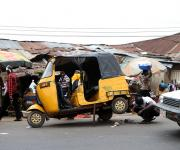 A man repairs a tricycle along a road in Beere district in Ibadan, South-west, Nigeria November 7, 2012.