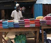 A man waits for customers at a roadside market in Ibadan, South-west, Nigeria November 7, 2012.