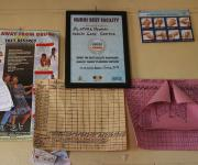 Hospital flow chats are pasted along a framed certificate of award on a wall at Alafara primary health centre in Ibadan, South-west, Nigeria November 7, 2012.