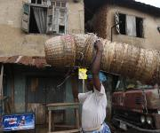 A woman carries a set of arranged baskets on her head in Mapo district in Ibadan, South-west, Nigeria November 7, 2012.