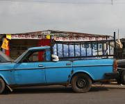 A man stands at the rear of a Volvo car converted to a load-truck in Molete district in Ibadan, South-west Nigeria, November 7, 2012