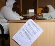 A document showing an approved budgetary allocation read in a speech for the family planning unit of Dutse Alhaji primary health care centre, is seen during an advocacy visit of the Nigerian Urban Reproductive Health Initiative(NURHI) staff, in Bwari distict outskirt of Nigeria's capital Abuja November 9, 2012.