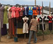 A man stands in front of a roadside boutique for women in Mapape village in the outskirt of Nigeria's capital Abuja November 9, 2012.