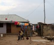 Children play in a compound at a slum in Mpape village village in the outskirt of Nigeria's capital Abuja November 9, 2012.