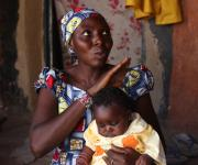 Ramatu Isah, a family planning user, describes her satisfaction during a visit of the NURHI advocacy team, outside her home in Jiwa village, outskirt of Nigeria's capital Abuja November 10, 2012.