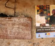 A poster campaigning for family planning with a language written in Hausa, is pasted on a wall beside a chalk-board outside the ancestral home of a local family planning campaigner, Aishatu Mohammed Jiwa, in Jiwa village, outskirt of Nigeria's capital Abuja November 10, 2012.