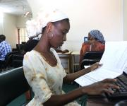 Abiola Olugbade, a  family planning data input officer, works in a room at the measurement, learning and evaluation office at the central business district in Nigeria's capital Abuja November 10, 2012.