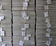 A stack of questionnaires is seen in a room at the measurement, learning and evaluation office at the central business district in Nigeria's capital Abuja November 10, 2012.