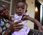 Hannah Moore sits with her mother during a testimonial interview on family planning usage with NURHI in their home in Karu village, outskirt of Nigeria's capital Abuja November 10, 2012