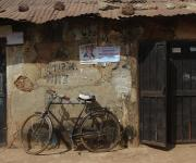 A bicycle is parked in front of a house in a slum in kakuri district  Nigeria's northern city of Kaduna, November  12, 2012.