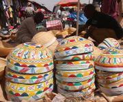 Calabash is displayed for sale as a mobilizer canvasses a man on family planning in a market in Kakuri district in Nigeria's northern city of Kaduna, November 12, 2012.