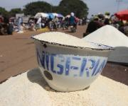 Cassava grain locally known as 'Gari' is displayed in a bowl with inscription 'Nigeria' in a market in Kakuri district in Nigeria's northern city of Kaduna, November 12, 2012.