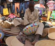 Muazu Mai Korya, a local craft man designing calabash, works without left arm in a market in Kakuri district in Nigeria's northern city of Kaduna, November 12, 2012.