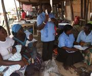 Mobilizers canvasses women on family planning in Romi market in Nigeria's northern city of Kaduna, November 12, 2012.
