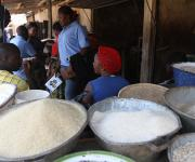 Mobilizers canvasses clients on family planning in a foodstuff stall at Romi market in Nigeria's northern city of Kaduna, November 12, 2012.