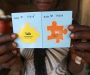 Comfort Chagari displays a family planning 'Go card' in a foodstuff stall after she was referred by a mobilizer at Romi market in Nigeria's northern city of Kaduna, November 12, 2012.
