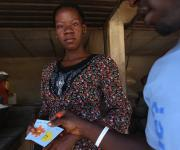 A family planning client Emmanuela Ogechikwu displays a 'GO card' after she was referred by a mobilizer at Romi market in Nigeria's northern city of Kaduna, November 12, 2012.