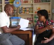 A patient medicine vendor counsels a family planning client, Joy Ezeonyesuchi at his outlet in Romi market during a family planning mobilization campaign in Nigeria's northern city of Kaduna, November  12, 2012.