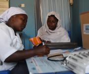A service provider attends to a family planning client, Farida Sabo in the counseling unit at the primary health centre, Tundun Wada Kujama district in Nigeria's northern city of Kaduna, November  13, 2012.