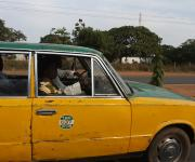 A taxi rides past on a road in Kaduna metropolis Nigeria's northern city of Kaduna, November 13, 2012.
