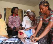 Participants demonstrate with a dummy during a training on post partum intrauterine contraceptive device (PPIUD) sponsored by NURHI at Nyanya general hospital in Nigeria's capital Abuja November 15, 2012.
