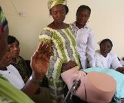 Participants listen to an instructor during a training on post partum intrauterine contraceptive device (PPIUD) sponsored by NURHI at Nyanya general hospital in Nigeria's capital Abuja November 15, 2012.