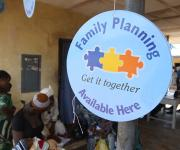 A dangler promoting family planning is hung in front of Orolodo primary health centre before the start of a visibility parade in Omuaran township in Nigeria's central state of Kwara, November 5, 2012.