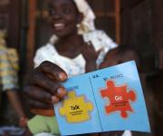 A  client, Moturayo Muritala, displays her 'Go card' after she was referred by a family planning mobilizer, during a visibility parade near Orolodo primary health centre in Omuaran township in Nigeria's central state of Kwara, November 5, 2012.