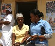 A family planning mobilizer refers a client, Tope Adeoye (L)  during a visibility parade at Orolodo primary health centre in Omuaran township in Nigeria's central state of Kwara, November 5, 2012.