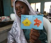 Modinat Bamidele displays her 'Go card' as she waits for a service provider at the family planning unit in Orolodo primary health centre in Omuaran township in Nigeria's central state of Kwara, November 5, 2012.