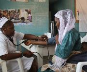 A service provider attends to Modinat Bamidele, a family planning client at the family planning unit in Orolodo primary health centre in Omuaran township in Nigeria's central state of Kwara, November 5, 2012.