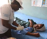 Modinat Bamidele lies on a bed as she receives a family planning injectable option at Orolodo primary health centre in Omuaran township in Nigeria's central state of Kwara, November 5, 2012.